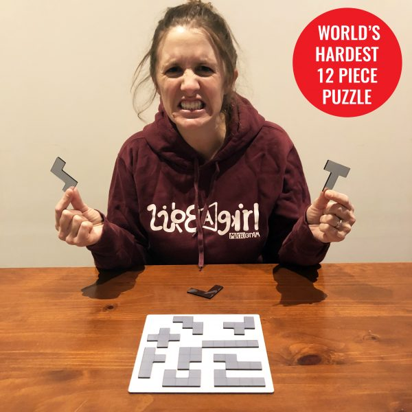 Person frustrated at not being able to solve the world's hardest 12 piece puzzle
